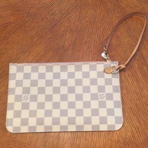 Louis Vuitton zipper pouch...